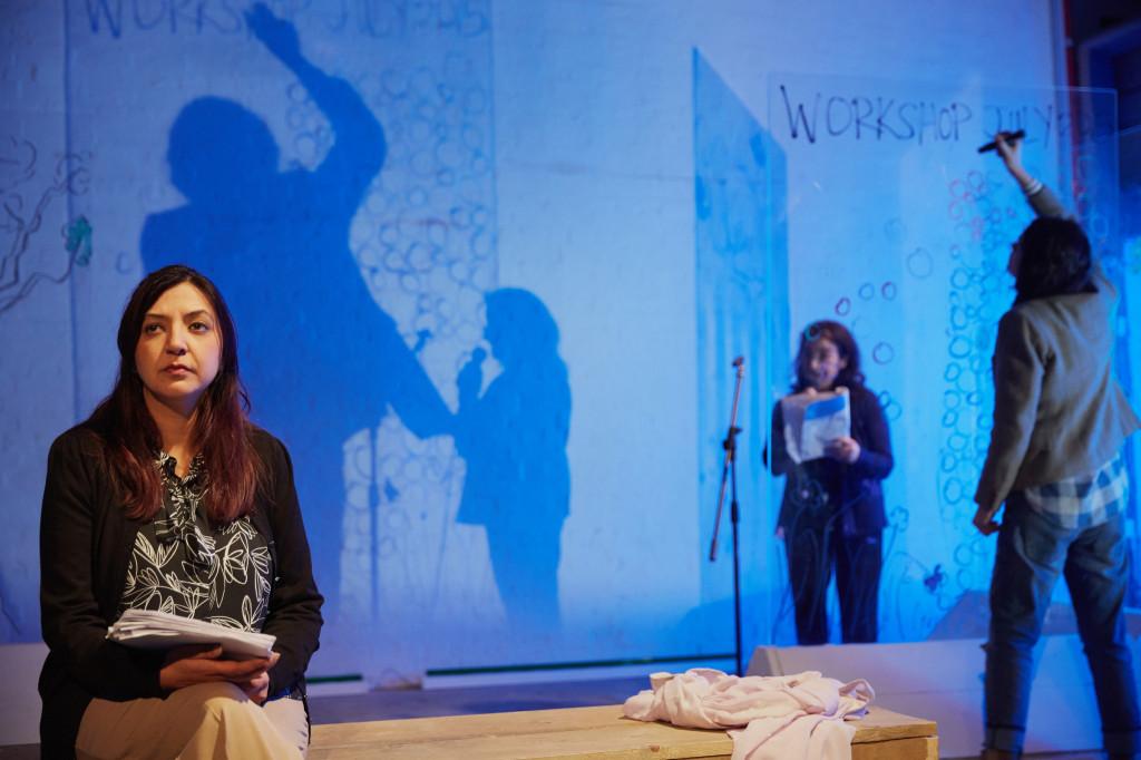 © Mark Douet, Anjali Mya Chadha (Ayesha), Mia Soteriou (Ila) by mic, Haley McGee (Deborah) writing on screen