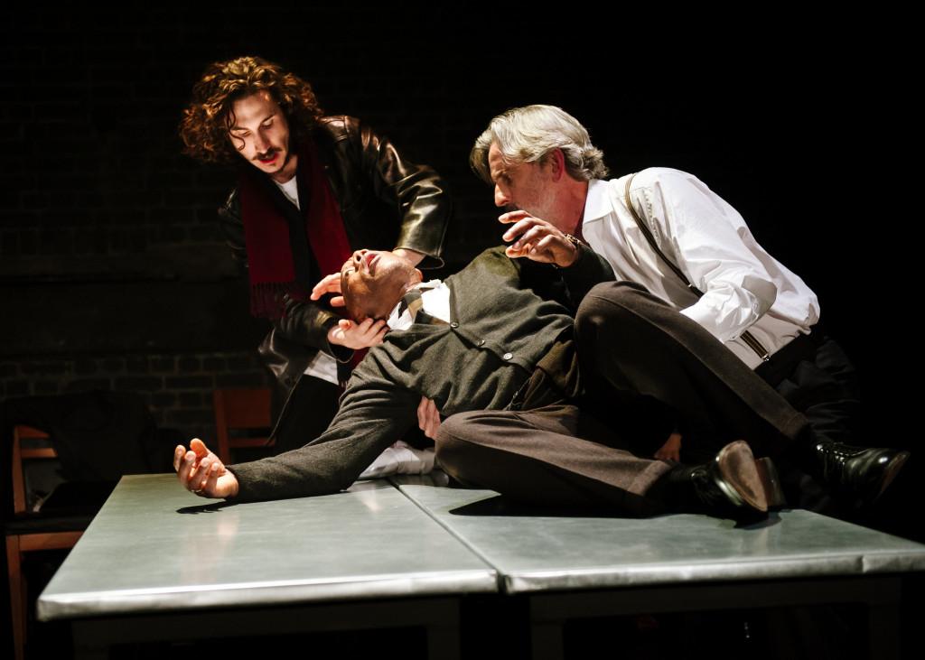 © Alex Brenner, Billy Postlethwaite (Raymond Rambert, journalist), Burt Caesar (Mr Grand, dying of the plague), Martin Turner (Jean Tarrou, a `good' man.