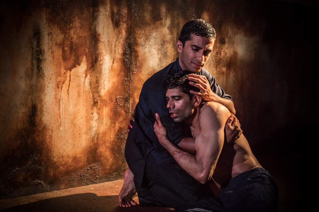 © Marc Brenner, Danny Ashok (Humuyan) comforts Darren Kuppan (Babur) full of contrition at the order he has carried out...