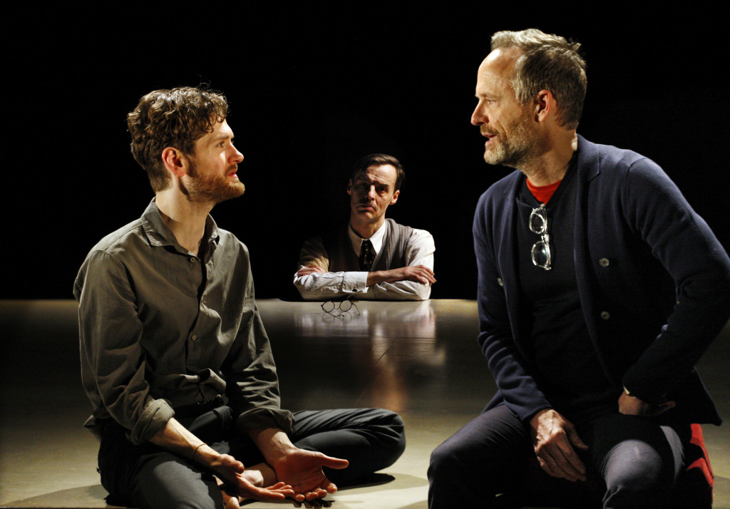 © Simon Annand, Kyle Soller (Eric), and John Benjamin Hickey (Henry) under the watchful eye of Paul Hilton aka E M Forster...