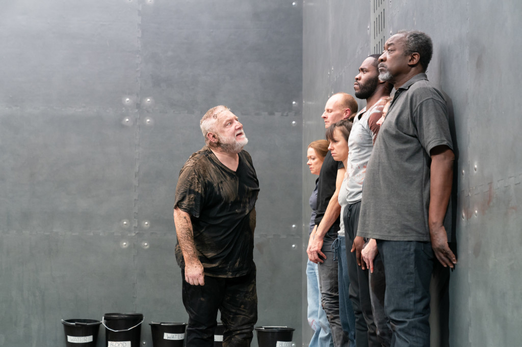 © Marc Brenner, Simon Russell Beale as Richard II in final moments of kingship berating the others, lords and bystanders - `conveyers', he calls them...