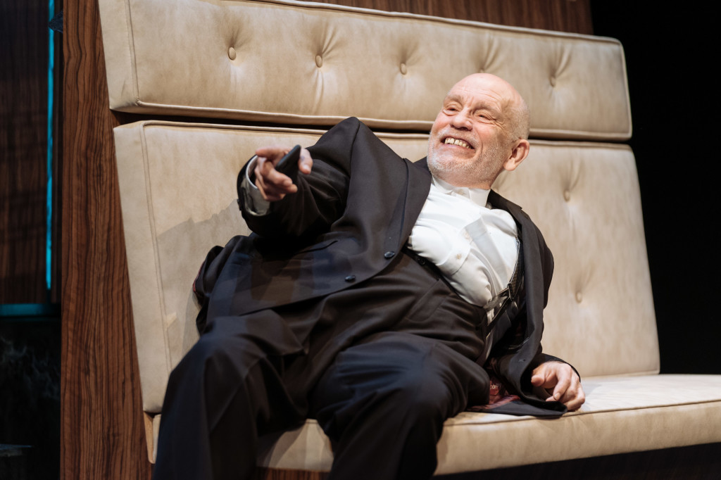 © Manuel Harlan, John Malkovich as Barney Fein, luxuriating in his gross misconduct...comic bravura...