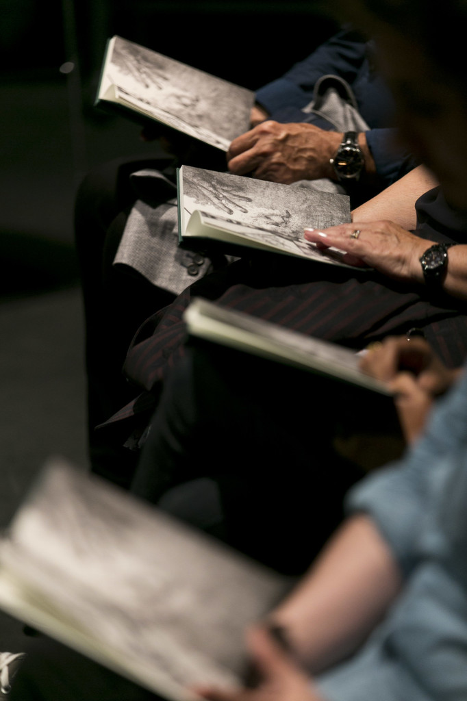 © Eoin Carey, audience members book in hand, reading collectively when instructed to do so...
