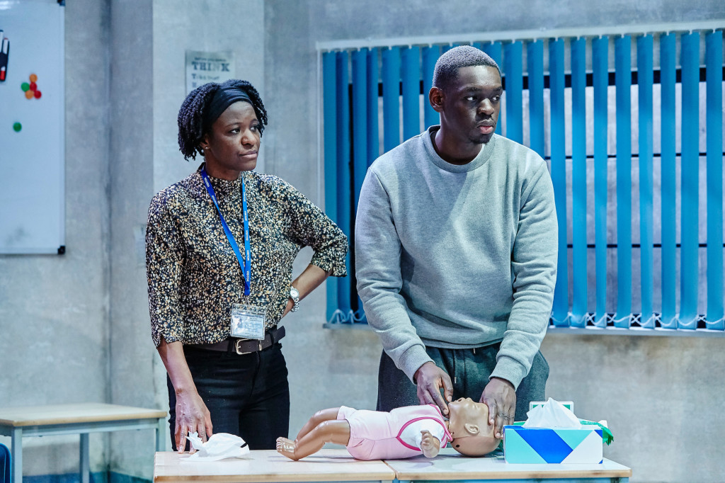 © The Other Richard, Andrea Hall as Grace, the parenting tutor and Ivan Oyik as Riyad - applying CPR to a  baby doll, no such help for these shattered lives...