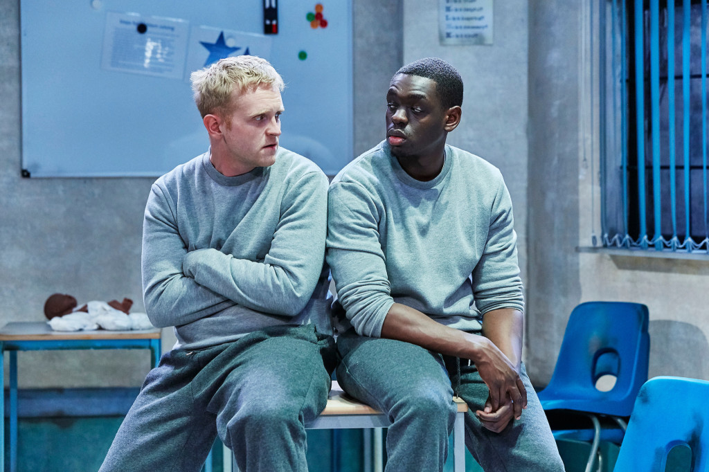 © The Other Richard, Josef Davies as Jonjo, stuck for words, Ivan Oyik as Riyad, befriending him within limiations...